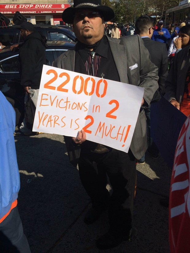 """The sign at the Renters March reads """"22,000 evictions in 2 years is 2 much!"""". 10/25/2014"""