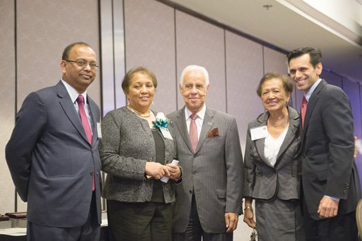 Jean Patterson Boone, publisher and president of the Richmond Free Press, accepted the Hill-Robinson Expansion of Freedom Award on behalf of her late husband, Free Press Founder Raymond H. Boone. From left: Dr. Niraj Verma, dean of Virginia Commonwealth University's L. Douglas Wilder School of Government and Public Affairs; Mrs. Boone; former Gov. L. Douglas Wilder; Dr. Grace E. Harris, retired provost and vice president of academic affairs at VCU; and VCU President Michael Rao.