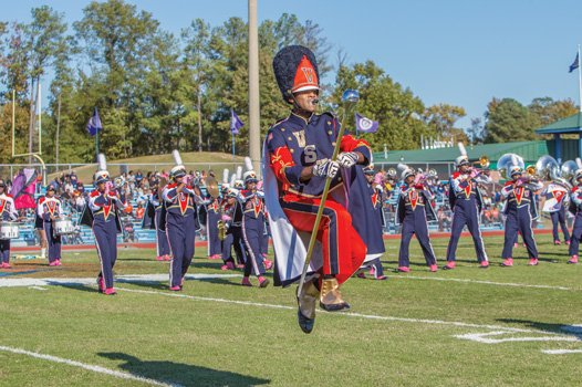 VSU drum major Samuel Jones of Hampton flies high as the band performs.