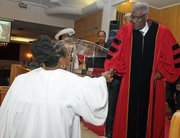 Minister Jolly  accepts congratulations from Reverend Clarence Norman Senior