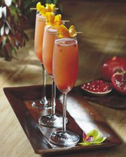 Tommy Bahama Pomegranate Mimosa   ¾ parts Pomegranate Syrup ¾ parts Fresh Orange Juice ½ part Luxardo Maraschino Liqueur 2 dashes Peychaud's Bitters 4 parts Brut Champagne   Pomegranate Syrup 1 cup sugar 1 cup Pomegranate juice Heat in a sauce pan, bring to boil Simmer for 10 minutes or until the syrup coats the back of a spoon Cool before using Store in a squeeze bottle and refrigerate 30 day shelf life   Add all ingredients except the champagne in a mixing glass, add ice and shake until chilled. Strain into the champagne flute, top with champagne and garnish with Pomegranate seeds and orange twist.