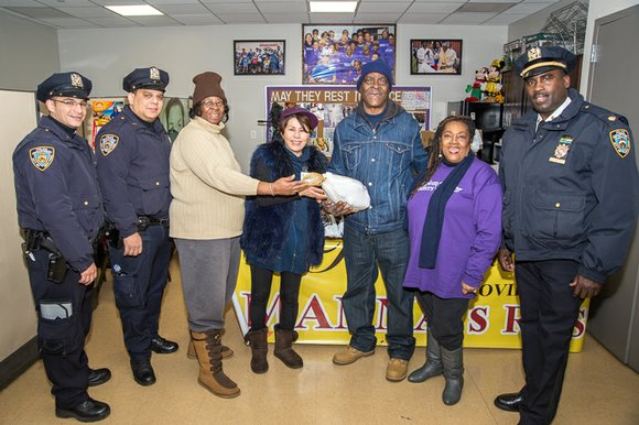 Friday, Nov. 21, more than 100 people and families who live on 128th Street between St. Nicholas Avenue and Frederick ...