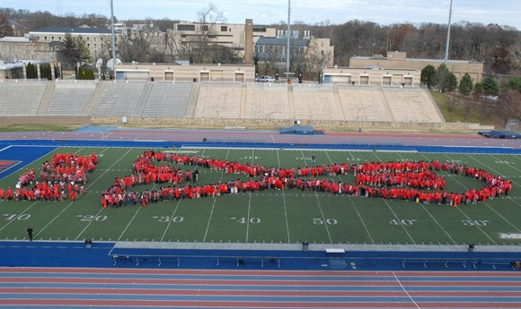 Local Baltimore organizations join in an attempt to make world's largest living red ribbon in commemoration of World AIDS Day