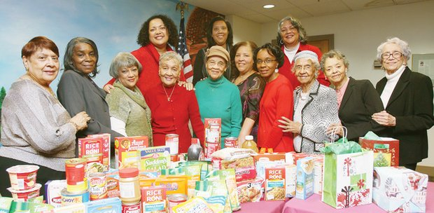 Members of the Mothers Club display food items collected recently for the kitchen at Hospital Hospitality House in Downtown. They are from left, front row, Grace Townes, Glenda Cooper, Charmaine Cooper-Jamison, Florence Cooper-Smith, Founder Esteletta Epps, President Esteletta Davis, Maridel Lee, Agnes Nicholson, Eleanor Binford and LaVerne Cooper. Back row, from left, Lisa Townes, Etta Plummer and Kathie Teasley.