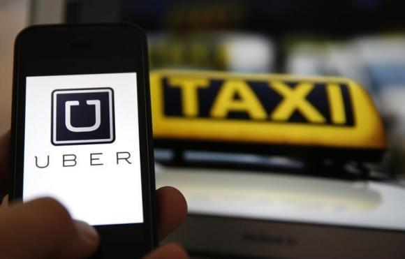 Kansas legislators voted to override Gov. Sam Brownback's veto of new, stricter regulations on companies like Uber, that allow people ...