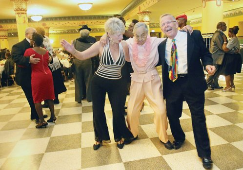 "Ninety-six-year-old Lulu Gault, center, boogies with with Judith and Ike Koziol at the Dec. 4 Holly Ball event — billed as an ""evening of holiday joy."" Location: The ballroom in the Altria Theater."