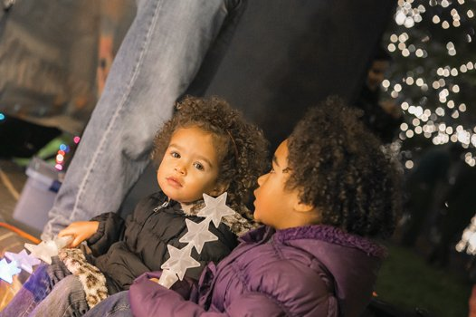 Two-year-old Olivia Cheek, left, and Aliyah Cheek, 5, are dazzled by the lights at the James Center Downtown during the 30th annual Grand Illumination last Friday.