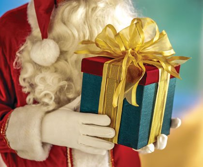 He's making a list and he's checking it twice -- but Santa Claus will have to wait for the January ...