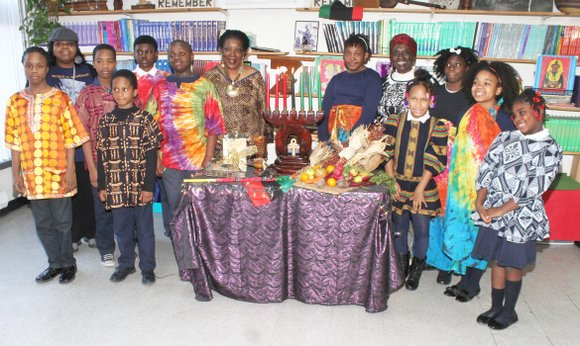 Kwanzaa, is celebrated from Dec. 26 to Jan. 1, and the children of Sankofa International Academy in Bedford-Stuyvesant, Brooklyn, held ...