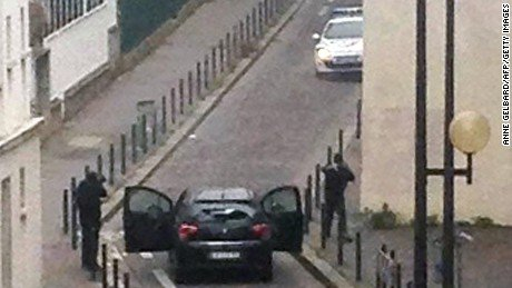 About 10 kilometers (6 miles) from the gas station, police blocked a rural country road leading to the French village ...