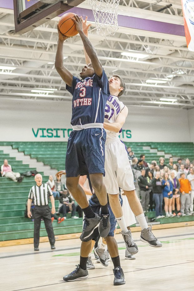 Maliek White goes up to score against James River High School. His talent on the court is attracting scholarship offers from colleges across the nation.