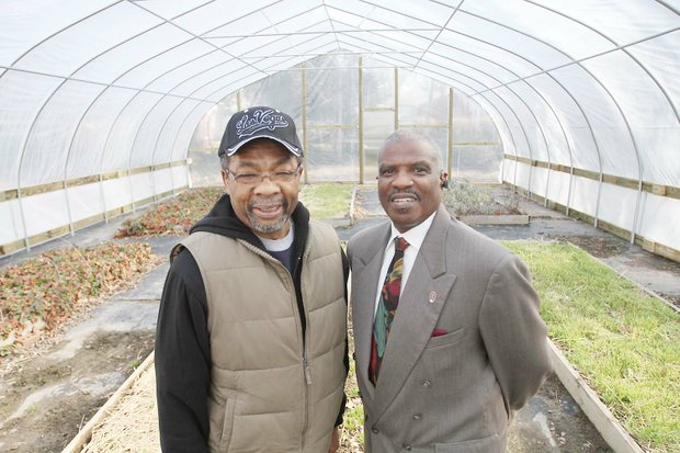 31st Street Baptist Church Dr. Morris Henderson, right, stands Tuesday with deacon and urban gardener Lee Marshall inside the hoop house behind the church.