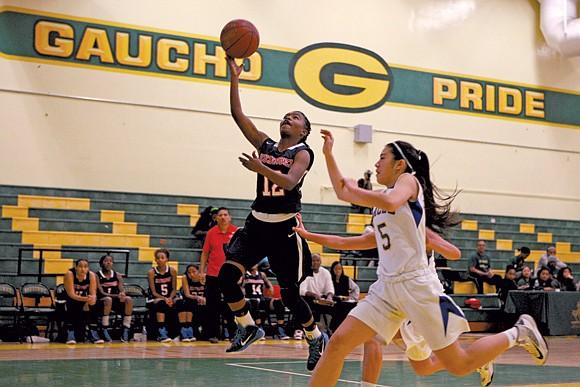 Leuzinger guard Tajaheray Mcmahon (12) led her team over Los Angeles CES./ OW photo courtesy of Jason Lewis