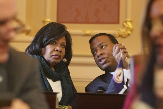 Virginia State Senators Rosalyn R. Dance of the 16th District (Petersburg) and Kenneth C. Alexander of the 5th District (Norfolk) chat in the Senate Chamber before the opening of the 2015 session of the General Assembly on Jan. 14, 2015.