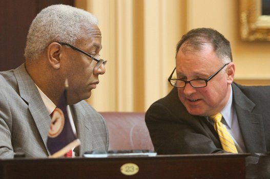 Virginia State Senators A. Donald McEachin of the 9th District (Henrico) and R. Creigh Deeds of the 25th District (Charlottesville) chat in the Senate Chamber before the opening of the 2015 session of the General Assembly on Jan. 14, 2015.