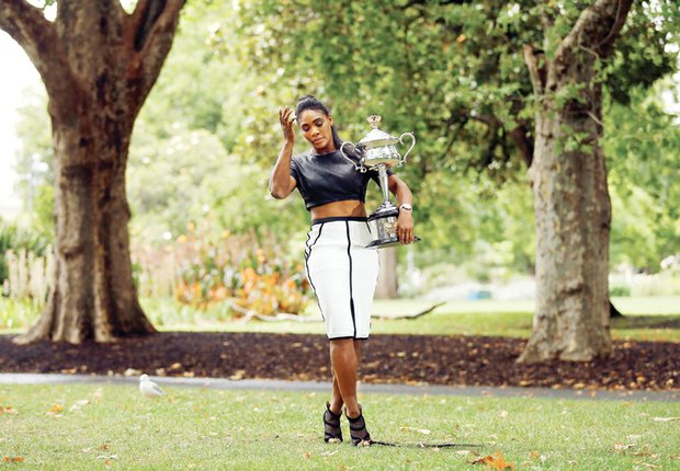 Serena Williams shows off the Daphne Akhurst Memorial Cup on Sunday, a day after winning the women's singles title in the 2015 Australian Open. The photo session took place at the Royal Exhibition Building in Melbourne.