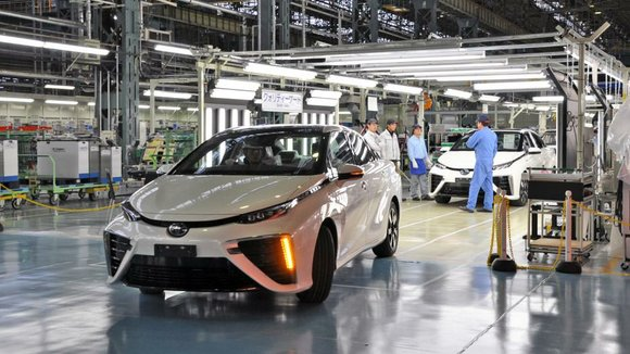 The disparities are stark between the petite workshop making Toyota's futuristic Mirai fuel cell sedan and the massive assembly lines ...