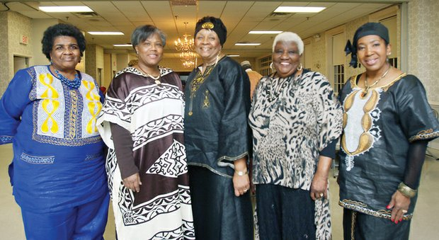 The Richmond Chapter of The Charmettes and their guests appear regal in their African attire at the organization's annual gala fundraiser at a Henrico County recreation center last Saturday. Right, Richmond chapter leaders, from left, include Mamie Nunery, president; Frances Scott, vice president; Darlene Nunery, acting event chair; Delores Murray, fundraising chair; and Sala Dabney- Powell, entertainment coordinator. The event included dinner, entertainment and dancing. The event supports cancer treatment, research and education.