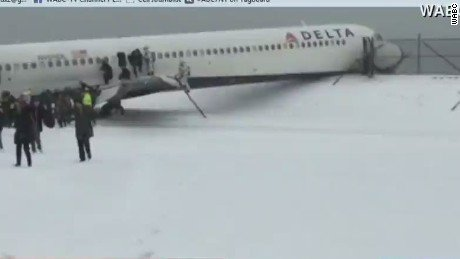 Delta Flight 1086 briefly circled New York City due to issues with snow and ice before touching down shortly after ...