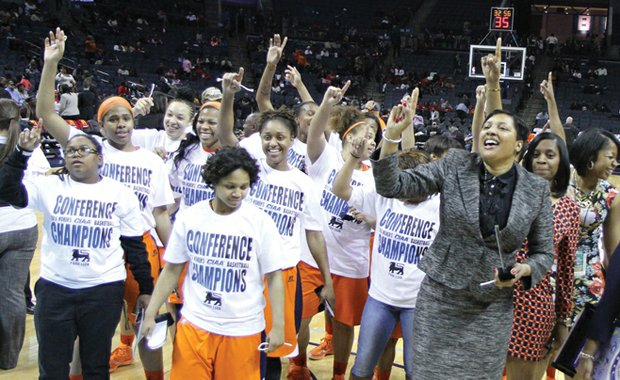 Virginia State University Athletic Director Peggy Davis, right, celebrates with the Trojans' women's basketball team following its 73-49 blowout of Lincoln University in the CIAA Tournament championship game last Saturday in Charlotte, N.C.