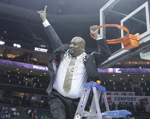 VSU women's basketball coach James Hill Jr. exuberantly signals his team is No. 1.