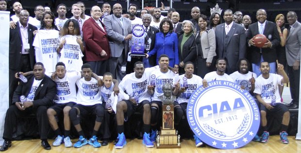 Livingstone College's men's basketball team and other supporters celebrate after the Blue Bears outran Winston-Salem State University's Rams in a 106-91 barn burner in last Saturday's CIAA title game at Time Warner Cable Arena in Charlotte, N.C.