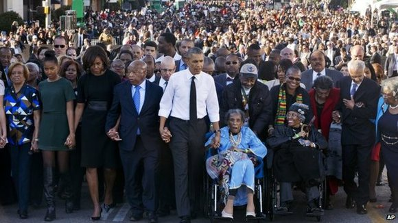 Crowds massed at a bridge in Selma, Alabama, Sunday to remember and reflect upon the sacrifices of another crowd that ...