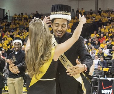Virginia Commonwealth University students Frankie James and Victoria Edwards ebulliently accept crowns during their coronation as 2015 VCU Homecoming King and Queen at the Siegel Center.