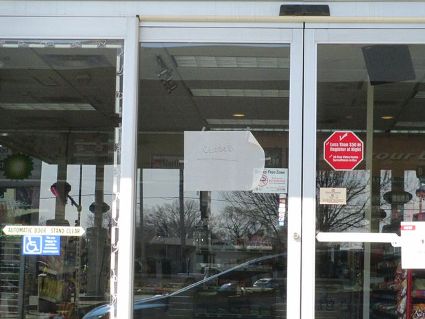 "A sign taped to the front door of the BP station at Jefferson Street and Hammes Road reads ""closed."""