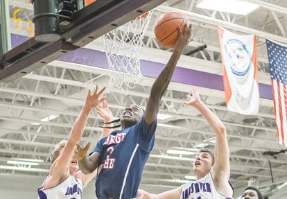 George Wythe High School's Maliek White stretches toward the hoop in a January basketball game against Chesterfield's James River High School.
