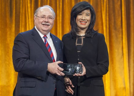Robert J.Kueppers, Senior Partner, Deloitte LLP and Board Chair, United Way of New YorkCity, with honoree Andrea Jung, President and CEO, Grameen America.