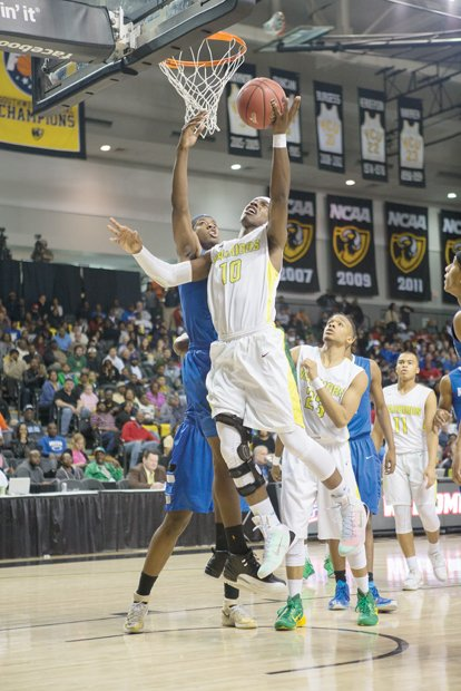 Henrico High School junior Monte Buckingham flies high to the basket in the Warriors' 78-64 win over Norfolk's Norview High School in the 5A state championship game at the Siegel Center.