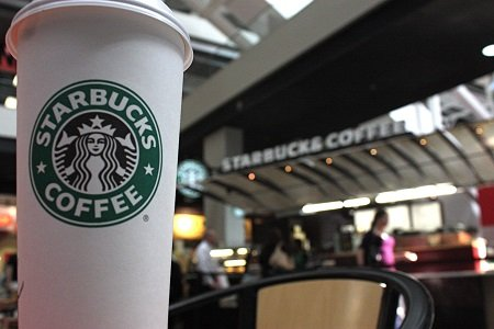 """Starbucks CEO Howard Schultz is urging his employees to embrace """"respect and dignity"""" in the face of an """"epic, unseemly ..."""