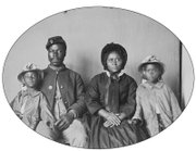 An unidentified Union soldier poses with his wife and two daughters in this photograph taken circa 1863-1865.