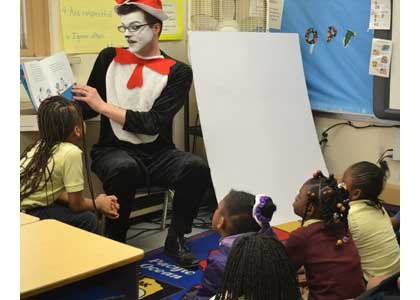 Baltimore partners, faculty, staff, friends and students of the University of Maryland, Baltimore (UMB) read to children on Friday, March ...