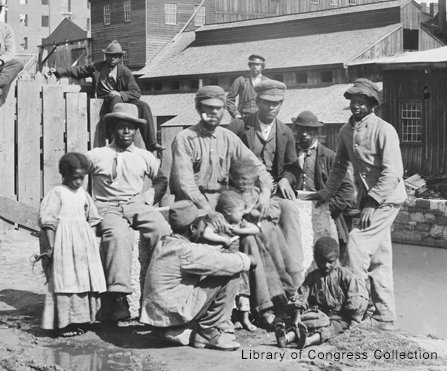 Newly emancipated children and adults at Haxall's Mill along the Kanawha Canal in Richmond on June 9, 1865.