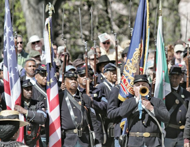 Re-enactors portray U.S. Colored Troops that helped liberate the city on April 3, 1865