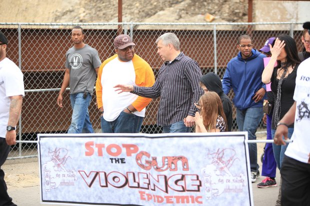 Joliet Mayor-elect Bob O'Dekirk speaks with a participant in Sunday's Men of Valor 2 prayer walk to stop gun crime in the city.