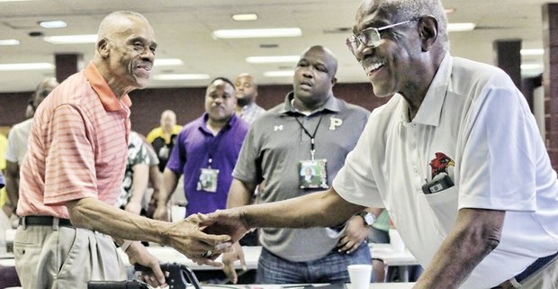 Former Virginia State University Coach Lou Anderson, left, receives congratulations on his Lifetime Achievement Award by friend and fellow Coach Willard Bailey at Virginia Union University's 2nd Annual Legends Clinic last Saturday.