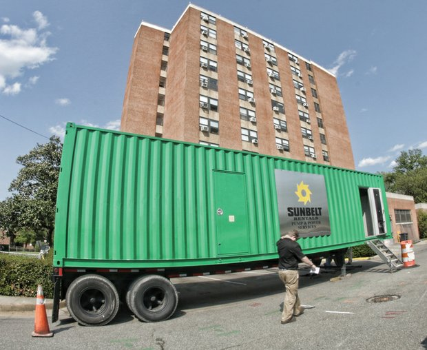 This large generator was set up Tuesday to provide power to residents of the 11-story Fay Towers. The electricity went out Sunday after squirrels damaged a power line leading into the building.