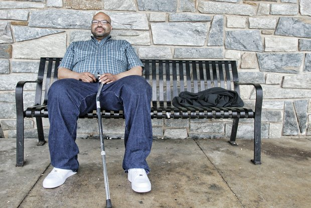 Roderyck Bullock waits patiently for one of GRTC's CARE vans to take him home from the city's Social Service Center on South Side. He only wishes, like many riders, that the service he relies on would be more reliable.