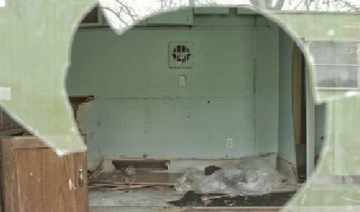 A view through a trailer's broken window shows the destruction inside
