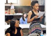 """Kelly McNeely listens to her 16-year-old daughter, Jaida Griffin recite her original poetry at the """"Black Words Matter"""" write-in, which was held on Sunday, May 3, 2015 in Baltimore."""