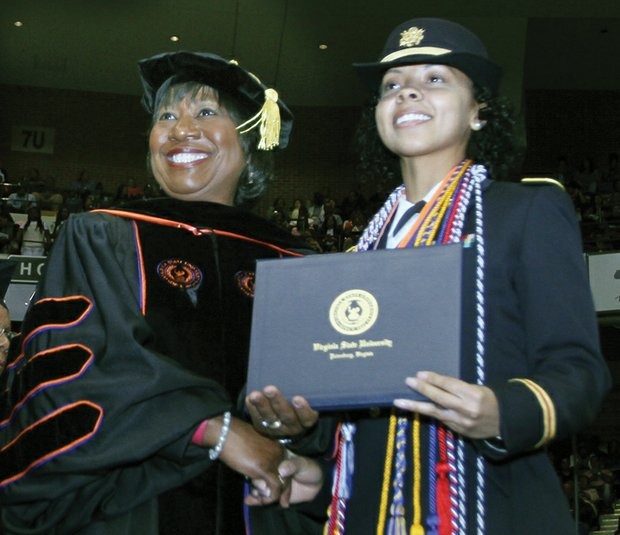 Interim Virginia State University President Pamela V. Hammond congratulates Arrisa Hanson as the top-ranking student in the graduating class. Ms. Hanson, who majored in psychology, earned a 4.0 GPA.