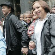 """""""American Idol"""" star Rayvon Owen walks through a sea of fans in Downtown with his biggest cheerleader — his mother, Patrice Fitzgerald."""