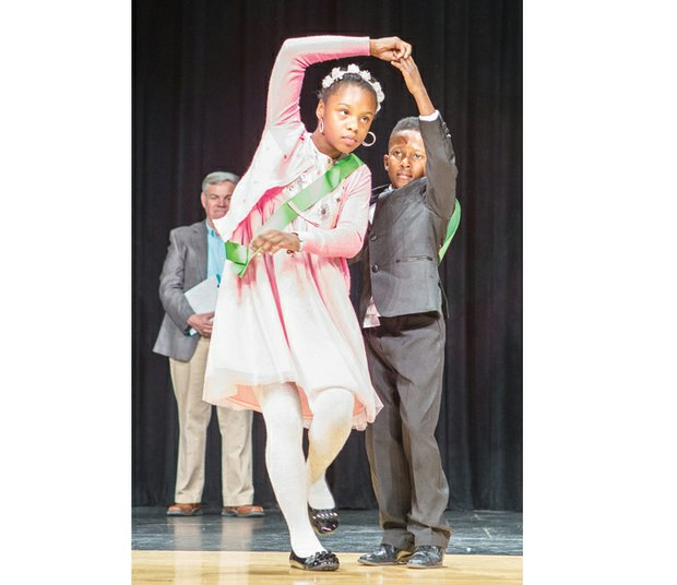 Dancing duo Anaya Jackson and Christopher Collins display precision ballroom dancing moves at Huguenot High School on South Side. The students were among teams from five Richmond elementary schools participating in the April 30 team competition of Dancing Classrooms Greater Richmond. The nonprofit organization aims to build social awareness, confidence and self-esteem in children through dance.