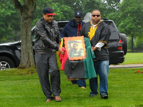 he celebration of what would have been the 90th birthday of slain international activist Malcolm X began with hundreds making ...