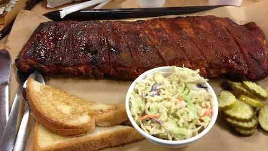 There's more than one bone of contention in the great finger-lickin' barbecue debate. Pork or beef? Vinegar- or tomato-based sauce? ...