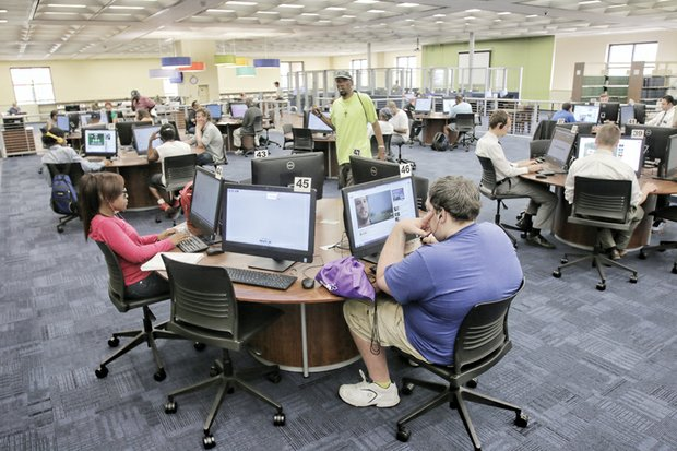 Main Library patrons work intently on computers on the second floor. The library now has 95 computers available to serve the public.