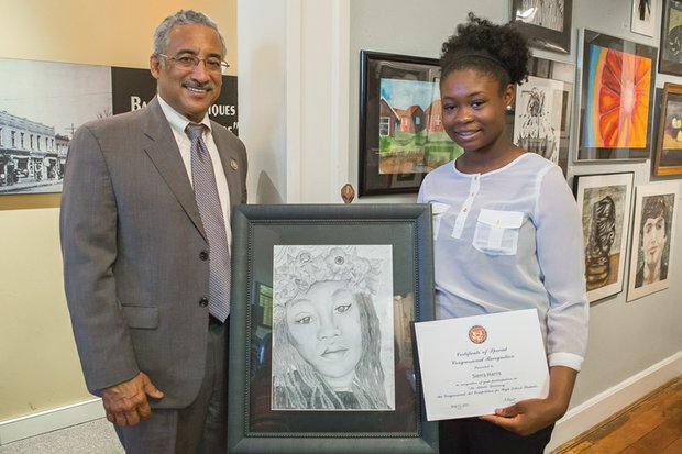 """Budding artist is official winner Congressman Robert C. """"Bobby"""" Scott presents Sierra Harris of Newport News and her winning work at Richmond's Black History Museum and Cultural Center of Virginia. The Woodside High School student was named the winner of the 22nd annual 3rd Congressional District Art Competition. The competition is open to all high school students in the congressman's district. It is part of An Artistic Discovery, a nationwide program coordinated by members of the U.S. House of Representatives to recognize the artistic talents of young people."""